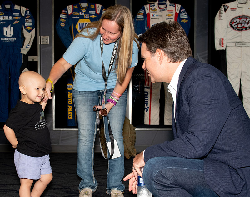 Jeff Gordon with pediatric cancer survivor, Merrit